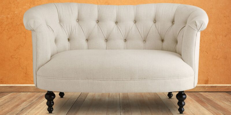 Enchanted Two Seater Chesterfield Sofa In Light Beige Colour