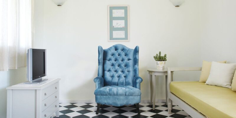 Arnova Velvet Wing Chair In Blue Colour