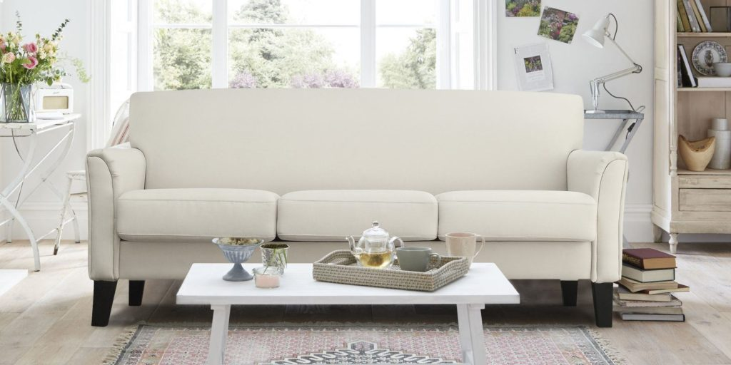 Modern Three Seater Upholstered Sofa In Off White Colour